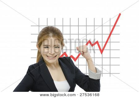 Successful business woman in front of rising line graph