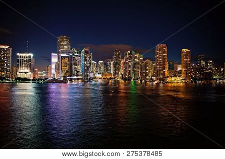 Miami Skyline Skyscrapers At The Night, Yacht Or Boat Next To Miami Downtown, Aerial View, South Bea