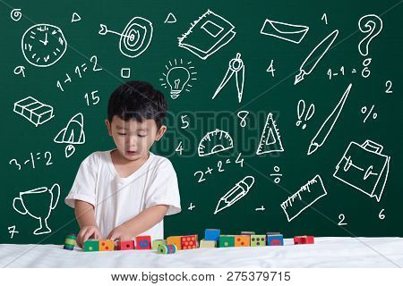 Asian Kid Learning By Playing With His Imagination About Stationery Supplies School Object Activitie