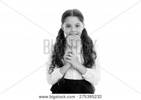 Enjoying delicious candy. Girl cute kid ponytails hairstyle eats sweet lollipop. Sweets in appropriate portions ok. Girl pupil school uniform likes sweets lollipop candy isolated white background. poster