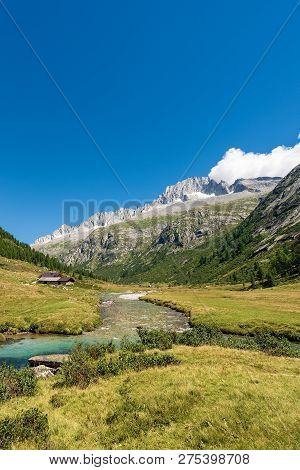 Peak Of Care Alto (3462 M) And Chiese River In The National Park Of Adamello Brenta Seen From The Va