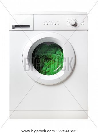 green laundry inside washing machine, isolated on white