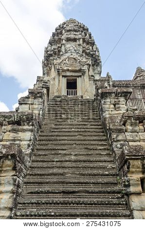 The Ogival, Redented Tower Shaped Like Lotus Bud Of Angkor Wat, And The Very Steep Stairways Represe