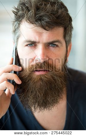 Bearded Man Hold Mobile Phone. Hipster Bearded Communicate Smartphone Call. Mobile Communication. Co