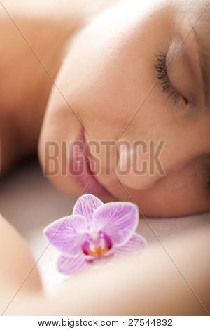 Close-up of a relaxed woman receiving spa treatment, selective focus