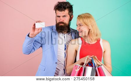 Man Bearded Hipster Hold Credit Card And Girl Enjoy Shopping. Ask Man To Purchase Lots Presents For