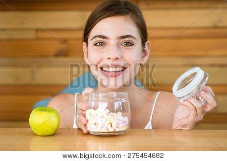 Sweet Temptation. Sugar Or Vitamin. Pretty Woman Prefer Marshmallows To Apple. Woman Choose What Foo