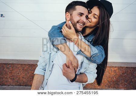 Young Beautiful Girl Hugging Her Handsome Boyfriend
