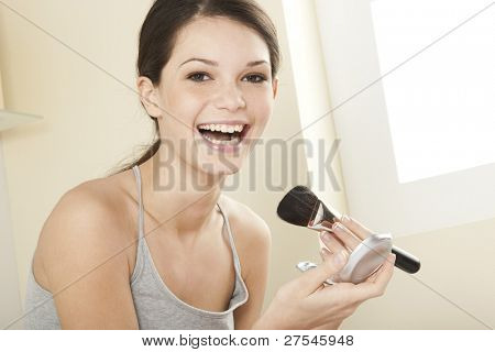 Teenage girl applying make up poster