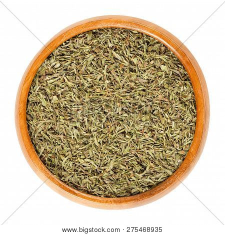 Dried Savory In Wooden Bowl. Chopped Summer Savory, Satureja Hortensis, A Herb And Seasoning For Bar