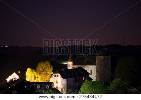 Burg In Wilderburg, Germany In The Dark With The Stars On The Background. Small Castle Kasteel.