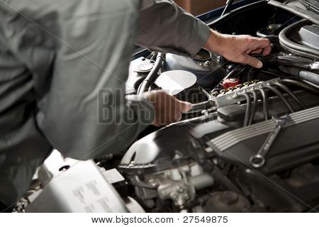 Male hand repairing car engine