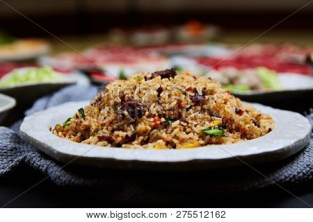 Fried Rice With Beef In A White Dish