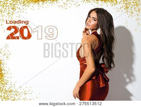 New Year Picture For Calendar Or Holiday Card. Attractive Lady In Red Dress With Bow On The Back. Go