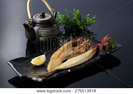 Fried Yellow Croaker In A Dark Plate