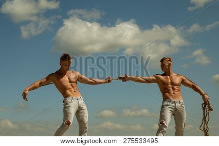 Opposites In Sport. Men Shows Off Their Strength Against Competitors. Athletic Twins On Opposite Sid