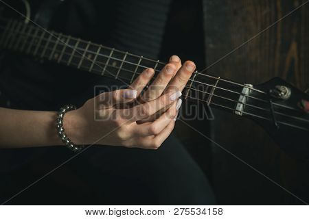 Music Is Their Passion. Couple Of Guitar Players. Couple In Love Play Duets. Male And Female Hands P