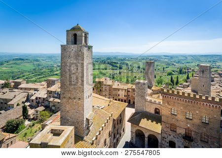 Aerial view of San Gimignano old town of towers and Toscana fields. Italy. poster