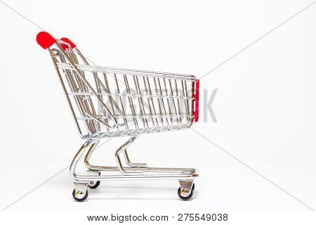 Basic Style Of Shpping Cart Close Up On White Background.  Copy Space On Left Side For Text Or Other