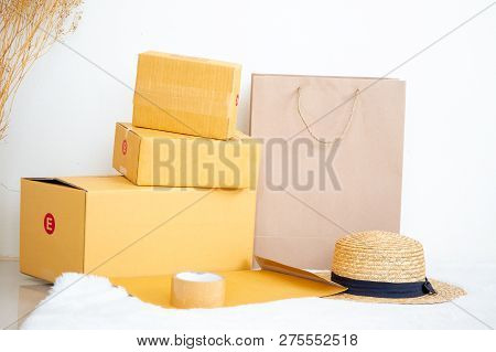 Empty Boxes And Shopping Bag And Hat Close Up.  Concept Of Online Shopping And Ecommerce.