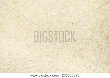 Thai Jasmine Rice Surface Close Up Background.