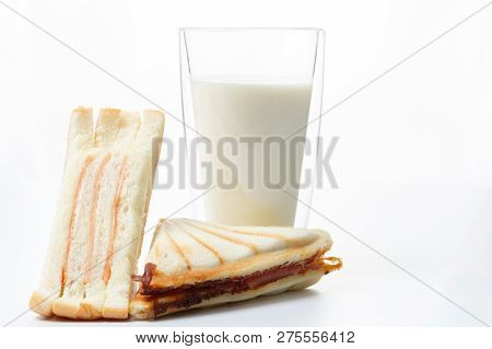 Baked Home Made Ham Cheese Sanwich And Fresh Milk Close Up On White Background.