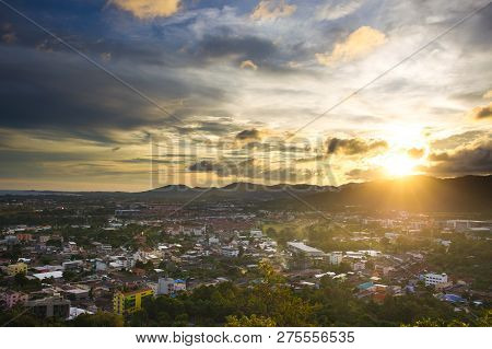 Landscape Of Down Town And Mountain During The Sunset.