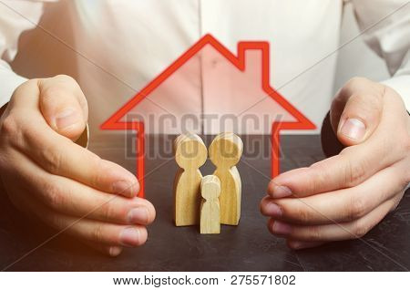 Insurance Agent Holds Hands Over Family. Family Care And Helping Hand Concept. Health Insurance. Hea