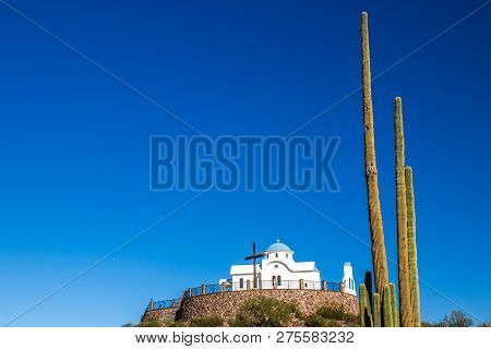 Monastery Chapel On Hilltop With Saguaro Cactus