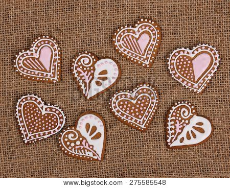 Baked Heart Shape Gingerbread Cookies On Burlap Background