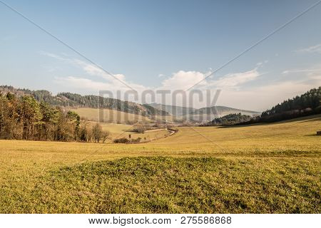 Beautiful Autumn Scenery Of Javorniky Mountains In Slovakia With Meadows, Smalleer Hills, Dirt Road