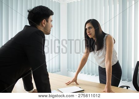 Confrontation Between Male And Female Partners. Young Caucasian Businesswoman And Businessman Having