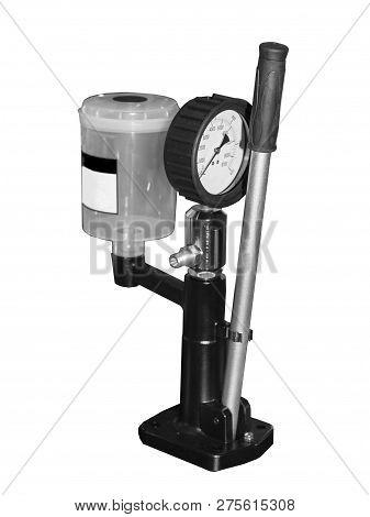Professional mechanics testing diesel injector in his workshop, repair and diagnostics equipment, soft focus poster