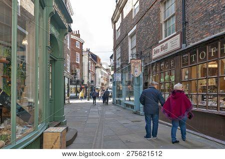 York, England - April 2018: Shops Along Minster Gates Street Near York Minster In Historic District