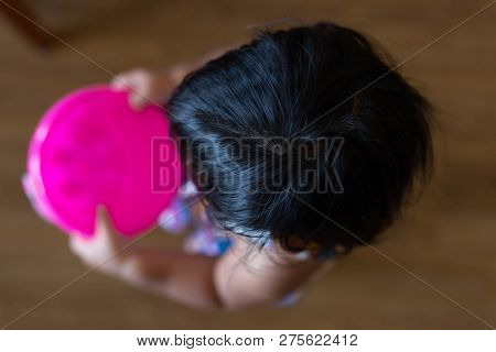 Lovely Little Girl Or Toddler Girl Is Holding Her Favorite Plastic Bucket And Waddling To Her Mother
