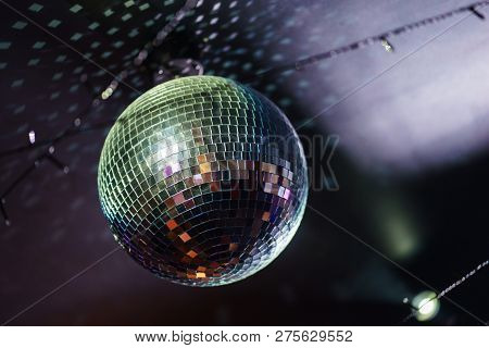 Bright Mirror Ball Disco Ball Under The Ceiling. Adult Entertainment, Disco And Night Club, Dancing.