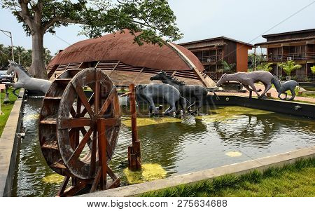 Architectural Design Of A Resort. Water Pool, Wheel, Sculptures Of Horses With Residential Buildings