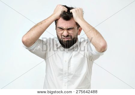 Enraged Young Businessman Pulling His Hair Out For Exasperation, Having A Burnout At Work