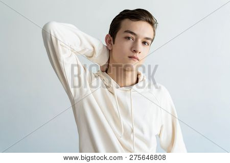 Confident Teen Boy Touching Neck. Attractive Guy Relaxing. Teen Boy Portrait Concept. Isolated Front