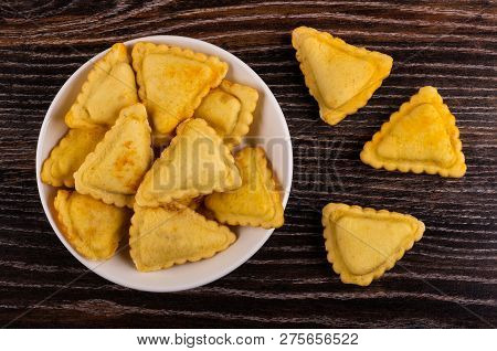 Small Fried Savory Pies In Plate, Pies On Wooden Table. Top View