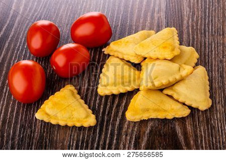 Small Fried Savory Pies, Red Tomatoes On Wooden Table