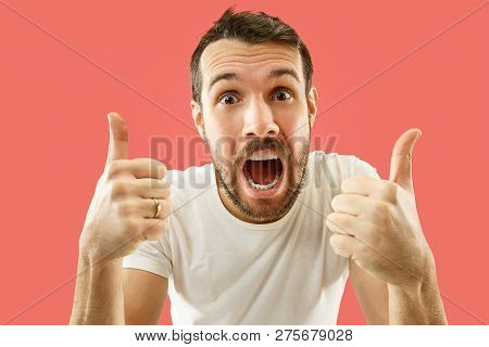 Wow. Attractive Male Half-length Front Portrait On Coral Studio Backgroud. Young Emotional Surprised