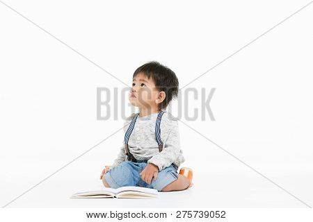 Studio Portrait Of Cute, Adorable, Asian Toddler Boy Wearing Denim Overalls, Long Sleeve T-shirt, Si