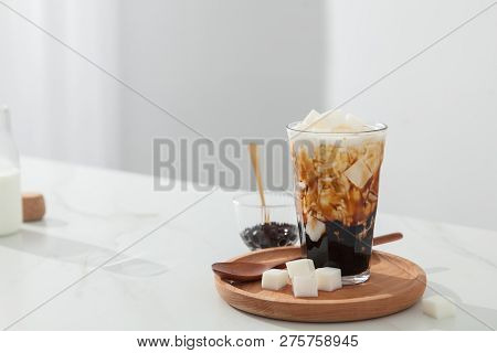 Coconut Pearl Milk Tea On The Wood Dish