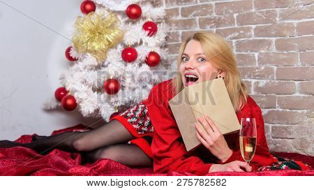 Celebrating christmas as introvert. Celebrate christmas without social obligations. Woman hold glass champagne and book. Girl relax near christmas tree. Alone on christmas. Holiday tips for introvert poster