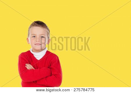 Photo little boy chid with a yellow background. Generation 2018