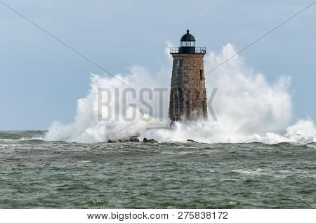 Giant Waves Reach The Top Of The Stone Tower Of Whaleback Lighthouse, Surrounding The Beacon During