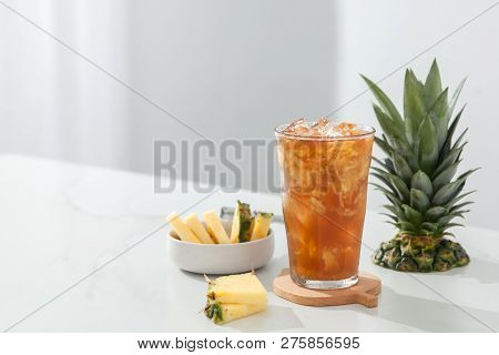 Honey Pineapple Fruit Tea In A Transparent Glass