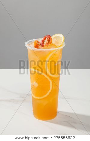 Loquat Sydney Orange Fruit Tea In A Transparent Glass