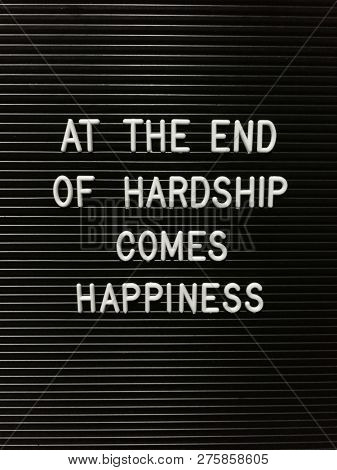 Quote on hardship and happiness